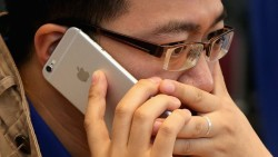 Apple's iPhones slowed to tackle ageing batteries