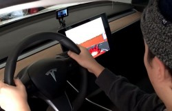 Tesla Debuts Steering Wheel-Controlled Pole Position Game Easter Egg For Model 3 And Model S