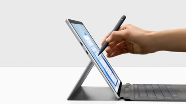A photograph of someone writing on the Microsoft Surface Pro X with a Microsoft Surface Slim Pen 2